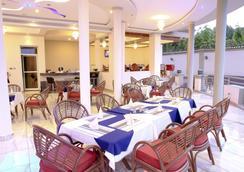 New Agena Hotel - Bujumbura - 餐廳
