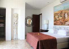 巴厘神秘酒店公寓 - 庫塔 - 臥室