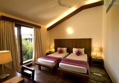 韋迪克村Spa度假酒店 - 加爾各答 - 臥室