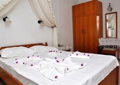 Jarra Hotel - 居姆貝特 - 臥室