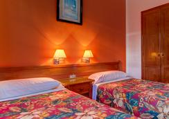 蒙大拿俱樂部套房酒店 - Puerto del Carmen - 臥室