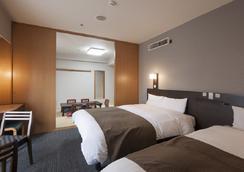 心齋橋溫泉多米高級酒店 - 大阪 - 臥室