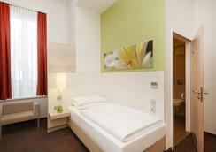 慕尼黑市中心H+酒店 - 慕尼黑 - 臥室