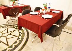 新瓦魯尼住宿加早餐旅館 - 達蘭薩拉 - 餐廳