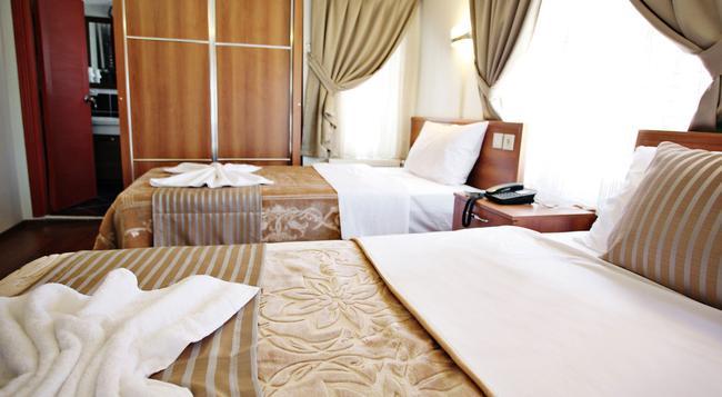 Taksim Palace Hotel - 伊斯坦堡 - 臥室