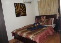綠洲達沃公寓式酒店 - 達沃 - 臥室