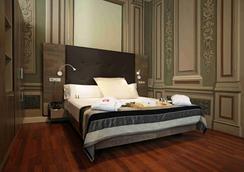 佩蒂特宮波蓋利亞花園酒店 - 巴塞隆拿 - 臥室