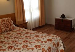 巴塔哥尼亞套房及公寓式酒店 - Trelew - 臥室