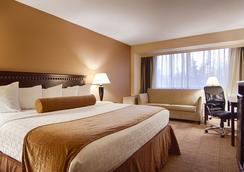 拉馬達卡里爾環島酒店 - 錫拉丘茲 - 臥室