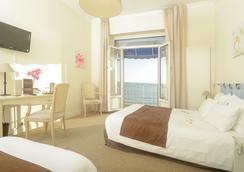 海灘大酒店 - 魯瓦揚 - 臥室