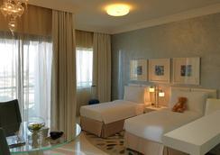 迪拜購物中心街達瑪克酒店 - 杜拜 - 臥室