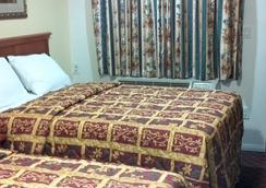 長灘陶爾汽車旅館 - 長灘 - 臥室