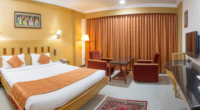 Ramyas Hotels - 蒂魯吉拉伯利 - 臥室