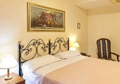 斯特隆伯利酒店 - 羅馬 - 臥室