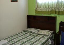 綠洲住宿加早餐旅館 - San Salvador - 臥室