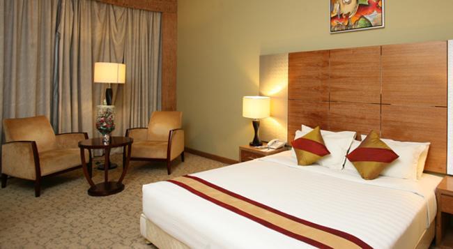 Rose View Hotel - 錫爾赫特 - 臥室