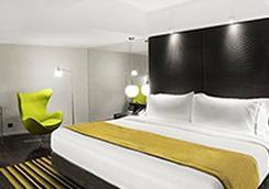 Uny Hotel - 日惹 - 臥室