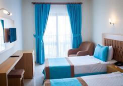 Sipark Boutique Hotel - 居姆貝特 - 臥室