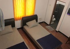 普拉旅館 - 萬隆 - 臥室