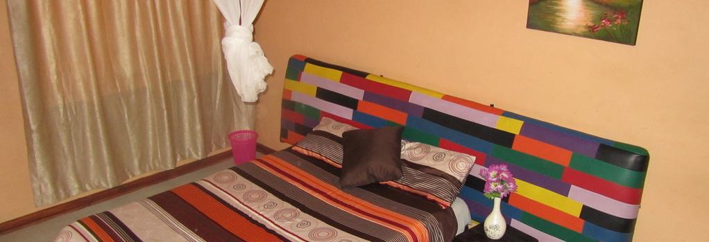 Flintstones Backpackers - Lusaka - 臥室