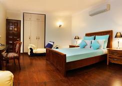 鱸魚阿伯套房旅館 - 古爾岡 - 臥室