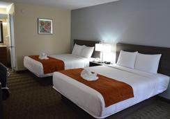 奧蘭多機場戴斯套房酒店 - 奧蘭多 - 臥室