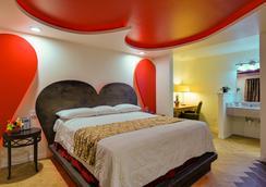 羅曼蒂克旅館和套房 - 達拉斯 - 臥室