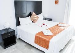 卡里博蓬塔卡納酒店 - Punta Cana - 臥室