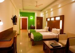 Hotel Inderlok - 德拉敦 - 臥室