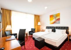 庫弗斯太達加州酒店 - 柏林 - 臥室