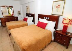 Tres Palmas Inn - 聖胡安 - 臥室