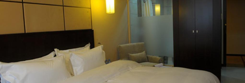 Baijia Hotel - 長春 - 臥室