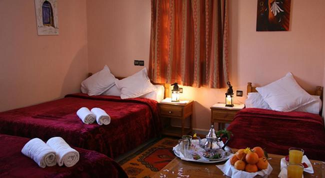 Hotel La Vallée - 瓦爾扎扎特 - 臥室