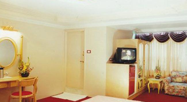 Hotel Swan Inn - 浦那 - 臥室