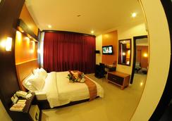 斯瓦納迪維帕酒店 - 巨港 - 臥室