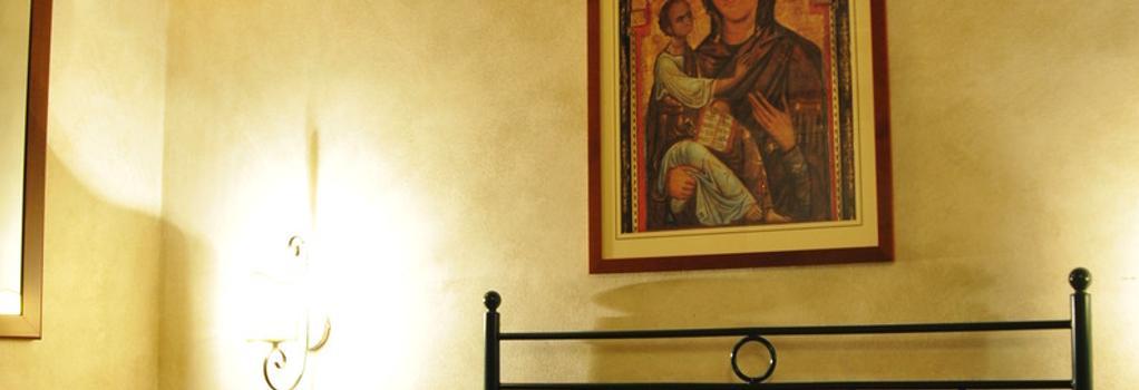 Casa San Tommaso - 比薩 - 臥室
