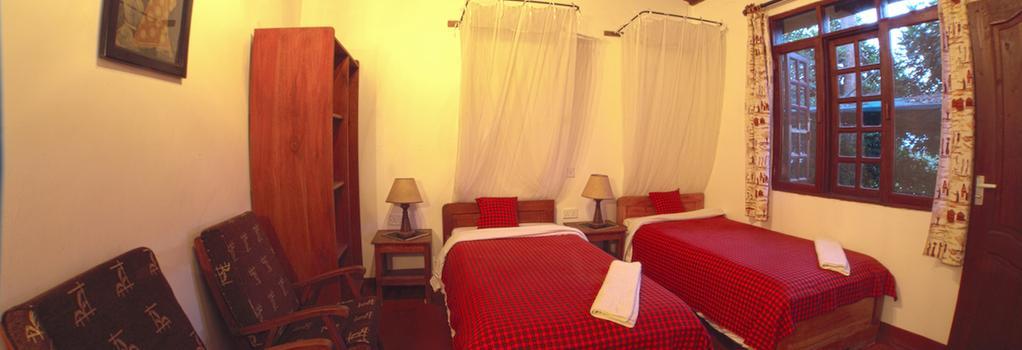 Safariland Cottages - 阿魯沙 - 臥室