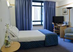 貴賓酒店 - 里斯本 - 臥室