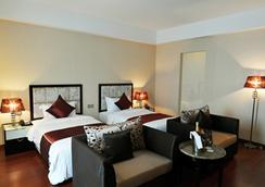 達拉機場酒店 - 金邊 - 臥室