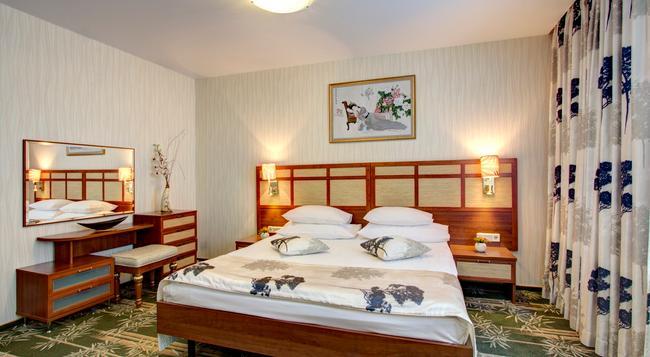 Izmailovo Alpha Hotel - 莫斯科 - 臥室