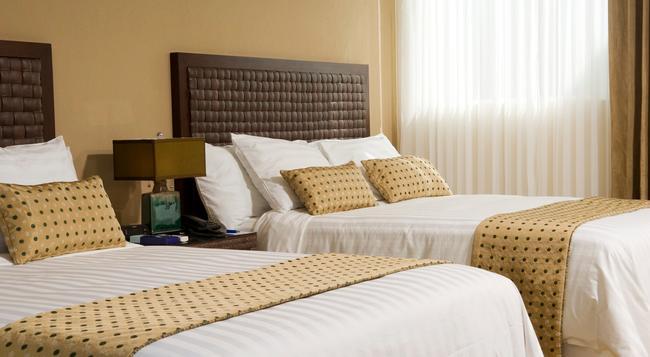 Rincón del Valle Hotel & Suites - San Jose - 臥室