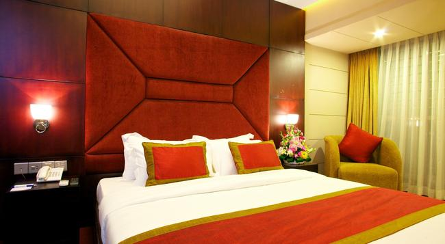 Hotel Orchard Suites - 達卡 - 臥室