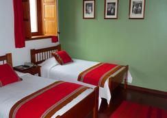 阿爾馬納住宿加早餐酒店 - 庫斯科 - 臥室