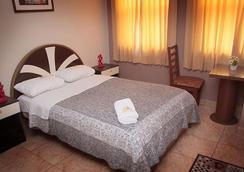 Hotel Arica - 齊克拉約 - 臥室