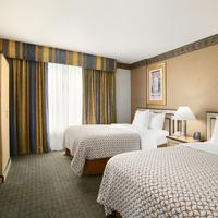 Embassy Suites by Hilton Convention Center Las Vegas Double queen bedroom suites are available for families or those traveling in groups.