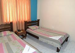 拉太陽門廣場酒店 - Bucaramanga - 臥室