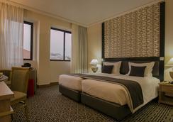 世界酒店 - 里斯本 - 臥室