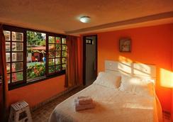 Suites Casa Do Barão - 布希奧斯 - 臥室