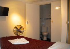 皇家倫敦酒店 - 倫敦 - 臥室
