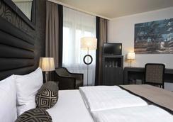 柏林托爾帕克酒店 - 漢堡 - 臥室